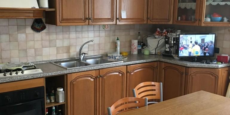 cucina abitabile con logo